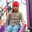 Girl slide playground — Stock Photo #7638640