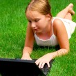 Girl computer grass - Stock Photo