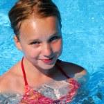 Girl in a swimming pool — Stock Photo