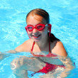 Girl swimming — Stock Photo