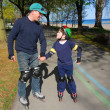 Stock Photo: Father son rollerblade
