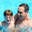 Royalty-Free Stock Photo: Father son pool