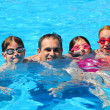 Happy family pool — Stock Photo