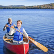 Family canoe trip - Stock Photo