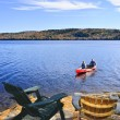 Canoeing on lake - Stock Photo