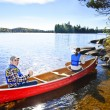 Stock Photo: Canoeing near lake shore