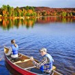 Canoing in fall — Stockfoto