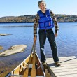 Man with canoe - Foto Stock