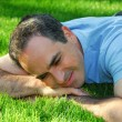 Man on grass — Stock Photo
