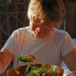 Eating senior woman — Stock Photo