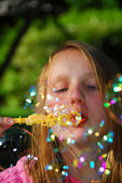 Young girl soap bubbles — Stock Photo