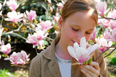 Girl with magnolia — Stock Photo