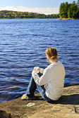 Woman relaxing at beautiful lake — Stock Photo