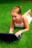 Girl computer grass — Foto Stock