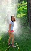 Girls and sprinkler — Stock Photo
