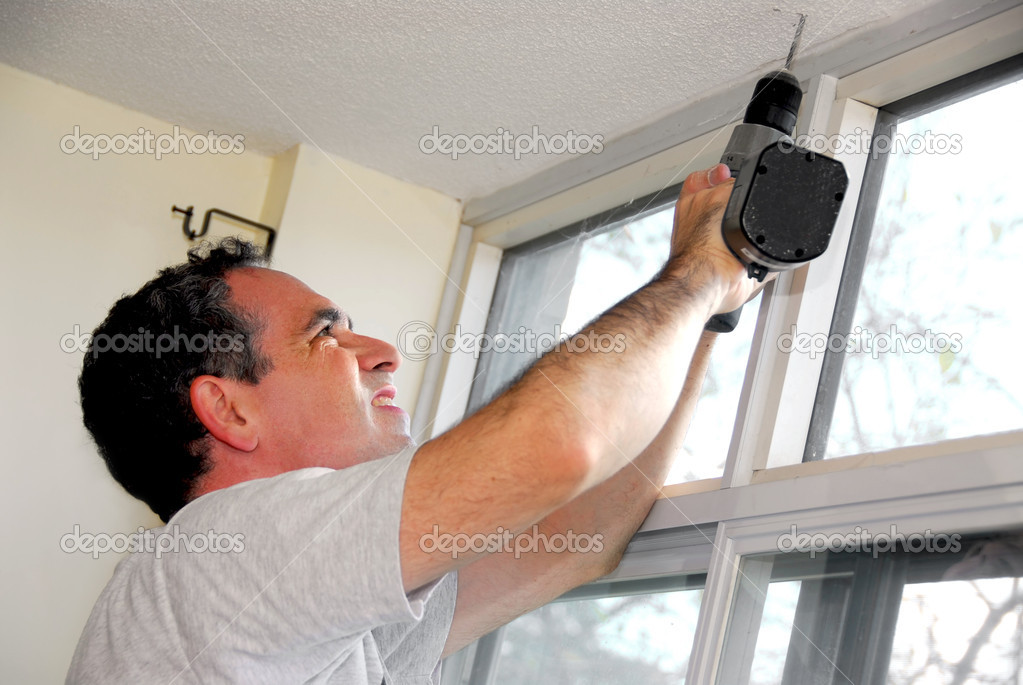 Man drilling a hole in a ceiling — Stock Photo #7639355