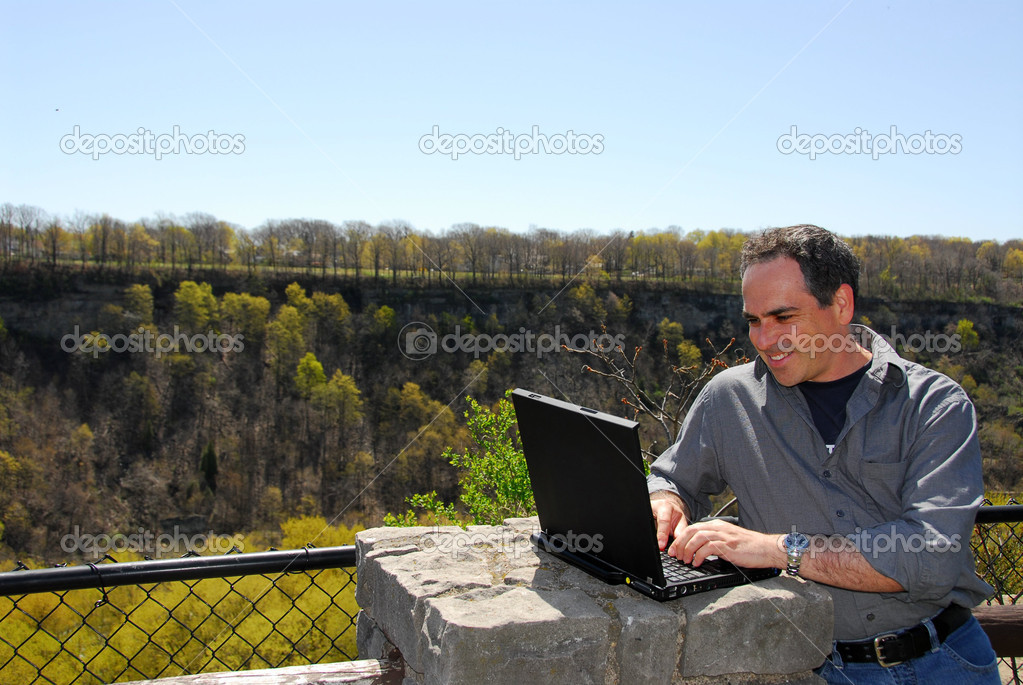 Smiling man working outdoors, wireless concept — Stock Photo #7639496