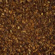 Dry loose Rooibos red tea, texture, background — Stock Photo