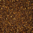Dry loose Rooibos red tea, texture, background - Stock Photo