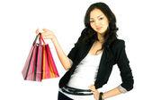 Asiatiche giovani donne con borse regalo, isolati su bianco — Foto Stock