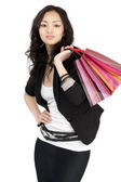 Asian young women with gift bags, isolated on white — Stock Photo