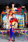 Harlequin lifting up Colombina and poodle — Stock Photo