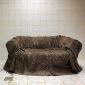 Old brown textile couch in bathroom — Stock Photo