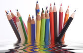 Different coloured pencils with reflection — Stock Photo
