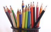 Different coloured pencils stood in pot — Stock Photo