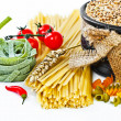 The composition of the pasta and vegetables on a white background — Stok fotoğraf