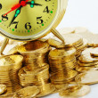 Stock Photo: Time is money - clock dial and golden coins