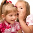 Two little girls are chatting — Stock Photo