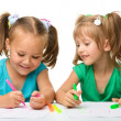 Two little girls draw with markers — Stock Photo #6768291