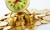 Time is money - clock dial and golden coins — Stock Photo