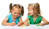 Two little girls draw with markers — Stock Photo