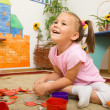 Little girl is playing in preschool - Stock Photo