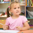 Little girl is drawing with felt-tip pen — Stock Photo #6817131