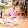 Little girl is drawing with felt-tip pen — Stock Photo #6817138