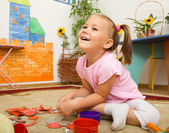 Little girl is playing in preschool — Stock Photo