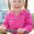 Cute little girl is swinging on see-saw — Stock Photo #6973906