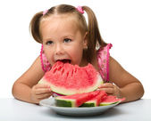 Cute little girl is going to eat watermelon — Stock Photo