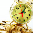 Foto Stock: Time is money - clock dial and golden coins