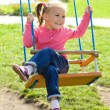 Cute little girl on swing — Stock Photo #6992222
