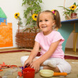 Little girl is playing in preschool — Stock Photo #6992243