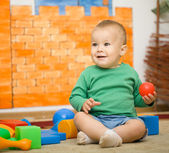 Little boy is playing with toys in preschool — Stock Photo