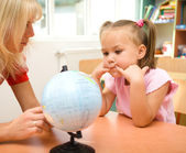 Little girl at geography lesson — Stock Photo