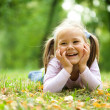 Little girl is playing in autumn park — Stock Photo #7178875
