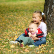 Children are playing in autumn park — Stock Photo