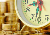 Time is money - clock dial and golden coins — Stok fotoğraf