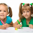 Royalty-Free Stock Photo: Two little girls draw with markers